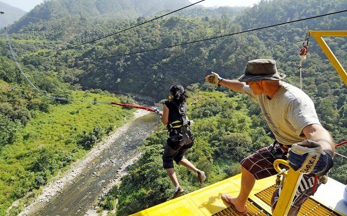 A woman in black bungee jumping in Rishikesh
