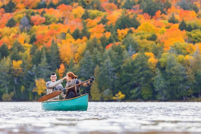 a couple rowing in a lake in canada