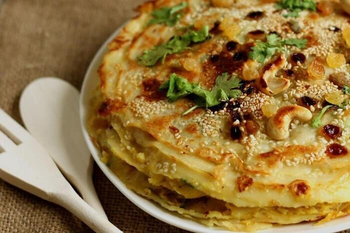 have Chatti Pathiri in Kerala, sweet cakes made out of crepe pancakes and dry fruits