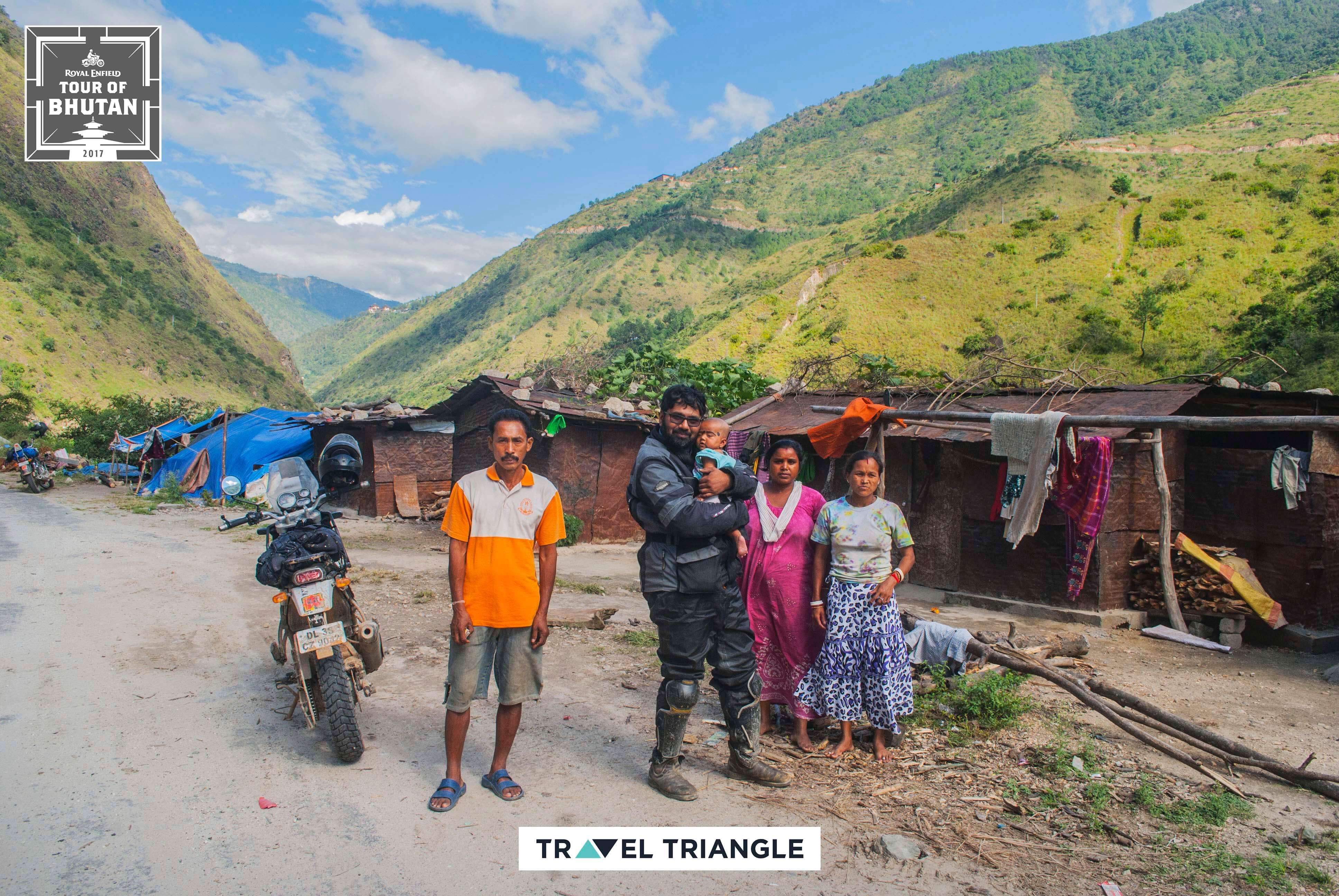 Mongar to Trashigang: riders meeting a family of friendly bhutanese people