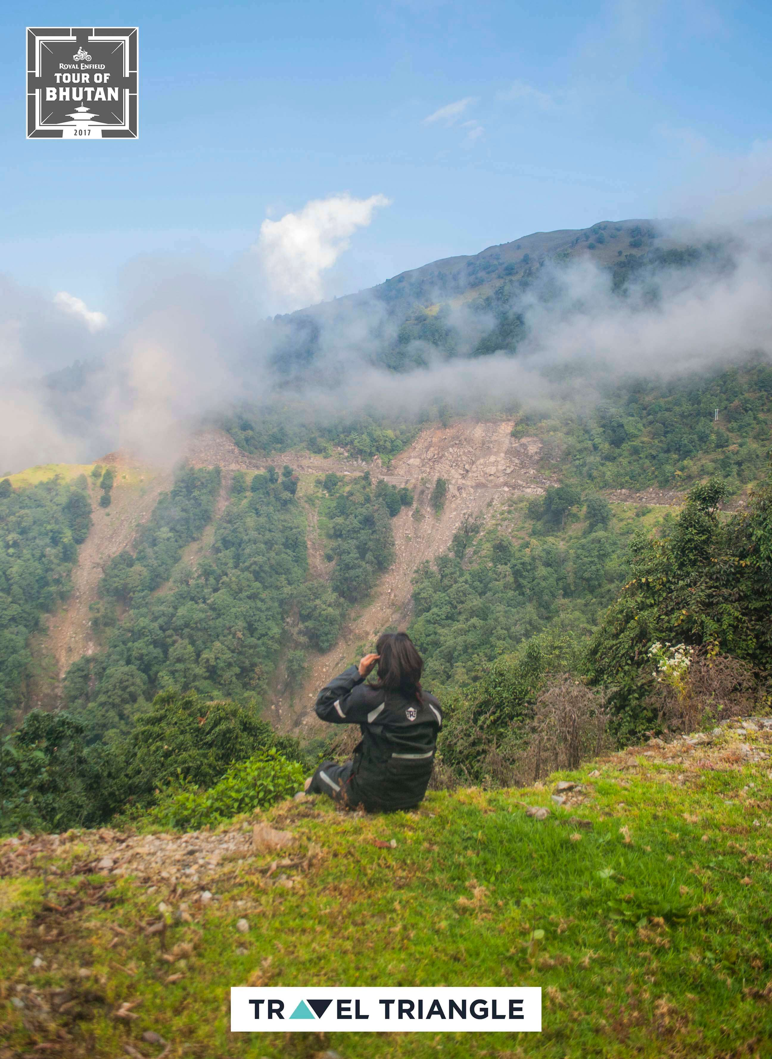 Trashigang to Samdrup Jongkhar: a female rider sitting on the edge of a hill