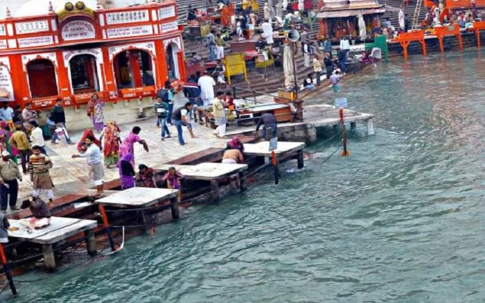 Devotees taking a holy bath at Gau Ghat in Haridwar