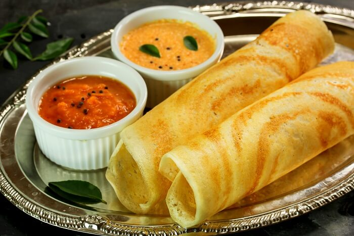 gorge on delicious Dosa Ghee Roast with sambar