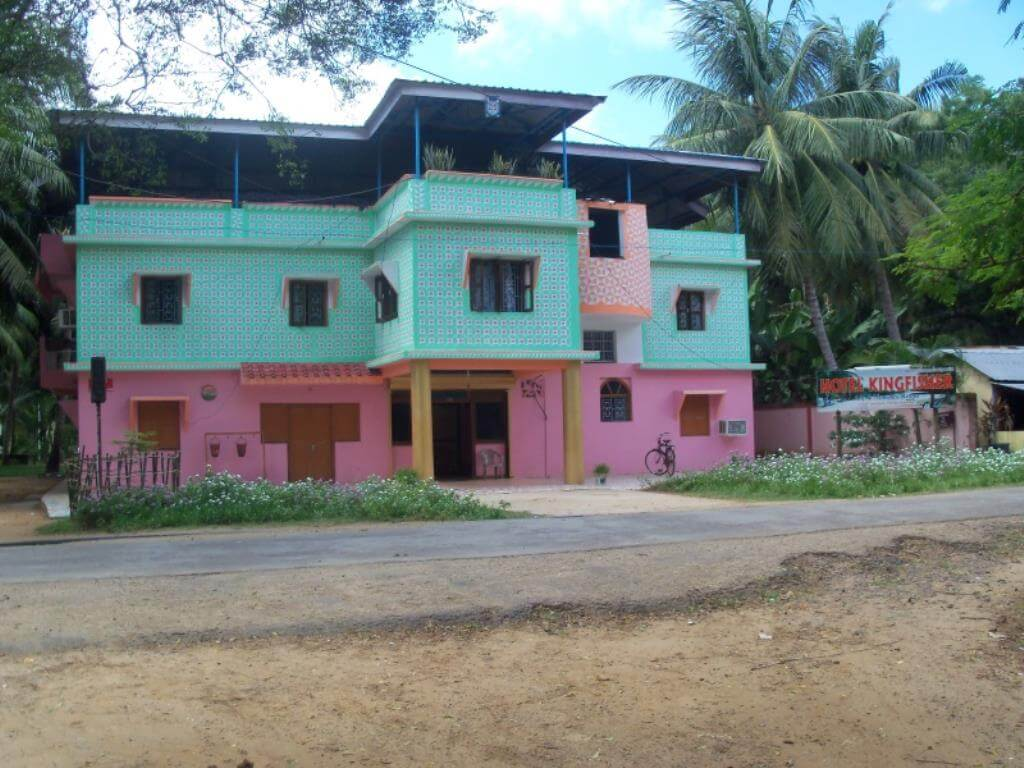 a budget hotel painted blue and pink