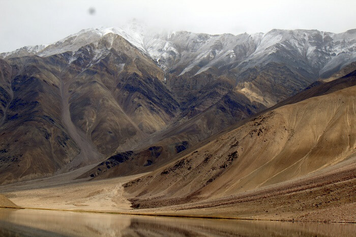 barren mountains at chandra taal lake