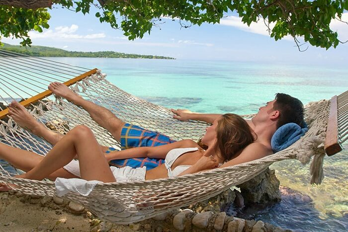 a couple enjoying beach time on their honeymoon in Jamaica
