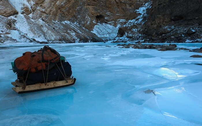 Luggage loaded on a sled over the frozen Zanskar river in Kashmir ss30102017