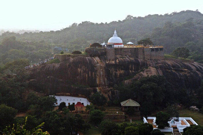 Seek blessings at the rock-cut monastery of Sithulpawwa
