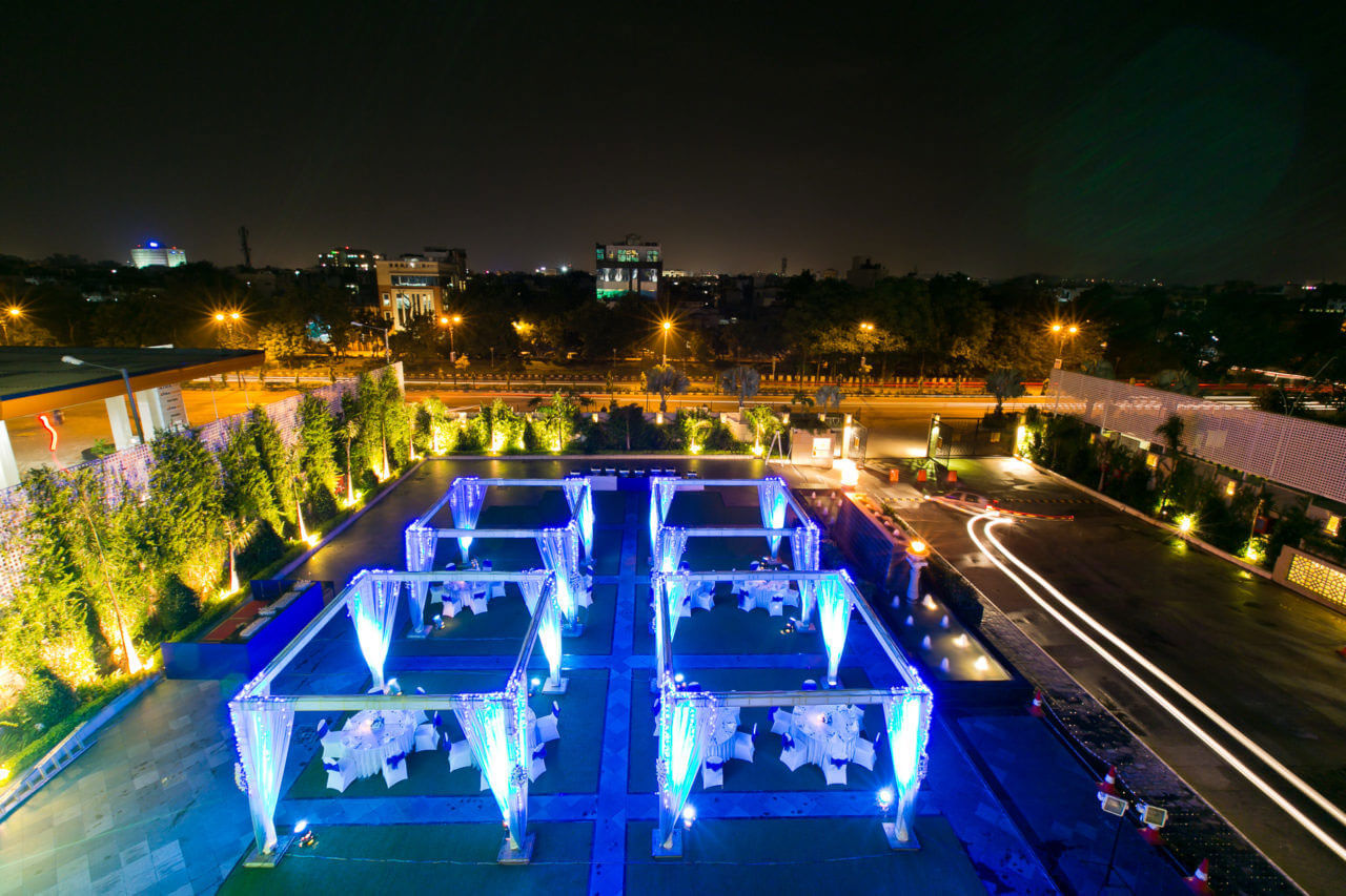 beautifully lit terrace sitting area of Lalit in Jaipur