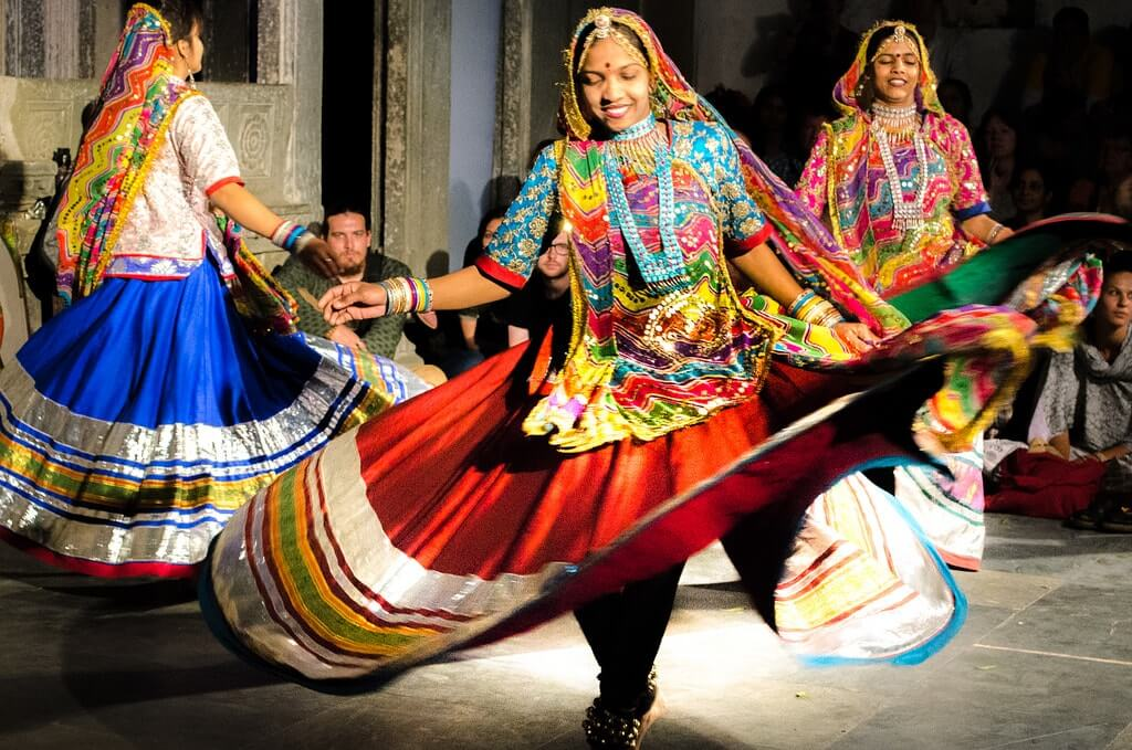 women dancing in traditional attire