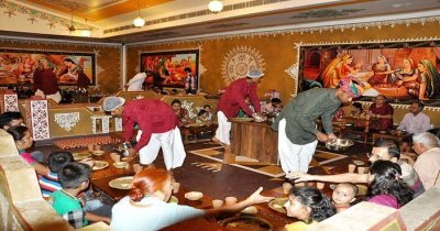 Rajasthani hosts serving for food to guests
