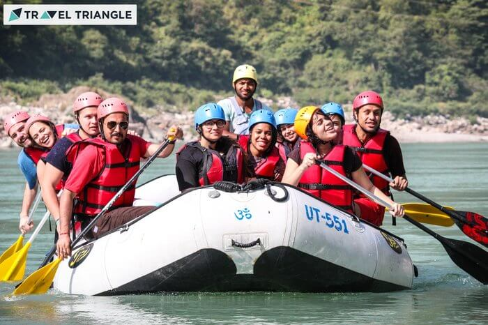a group of people rafting in Rishikesh