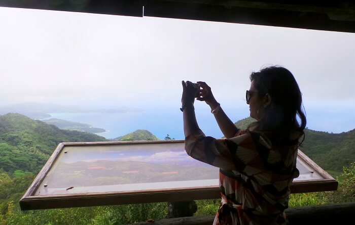 Woman clicking a picture in Seychelles