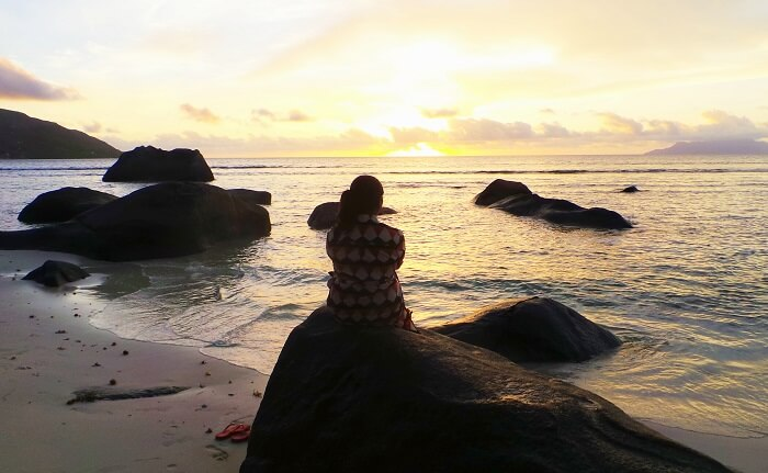 Woman enjoying sunset in Seychelles