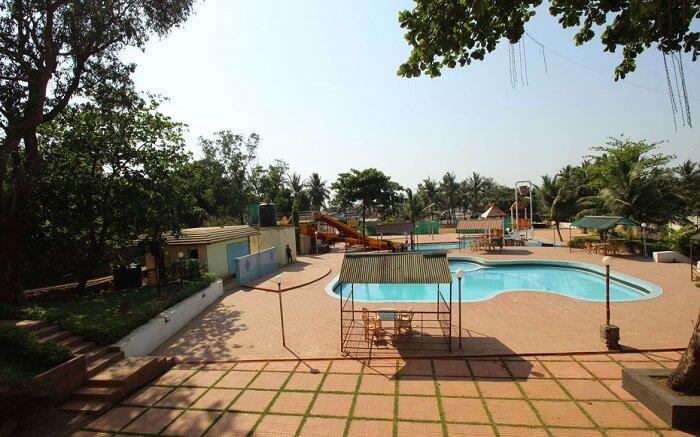A pool view of Krishna Resort and Waterpark in Mumbai
