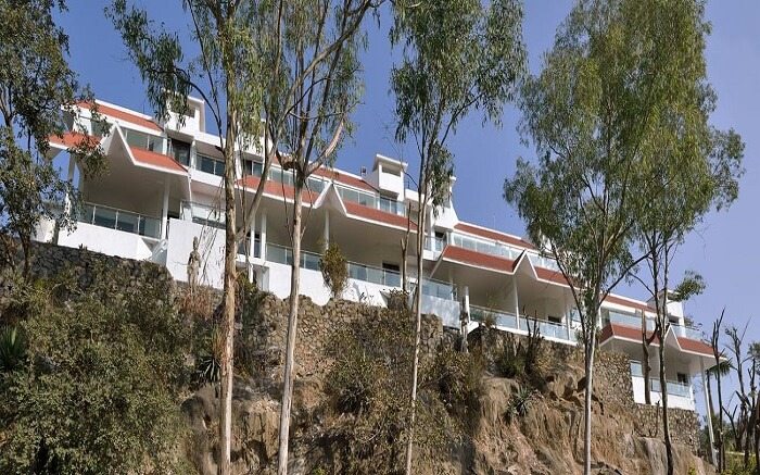 A view of Aranya Resorts perched atop a lofted platform in Mount Abu