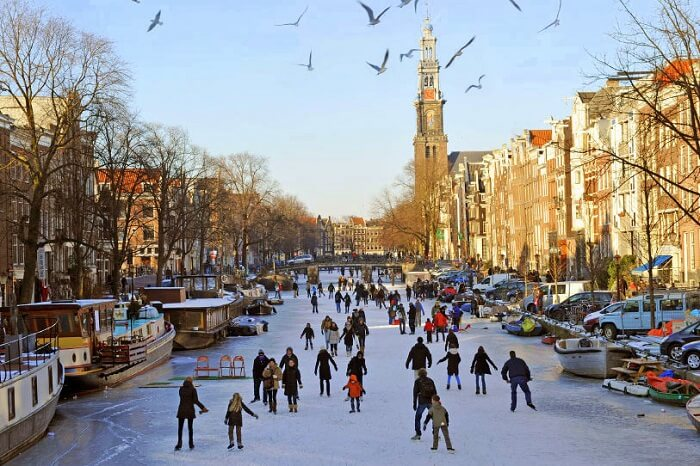 Go ice skating in Amsterdam's frozen canals in winter
