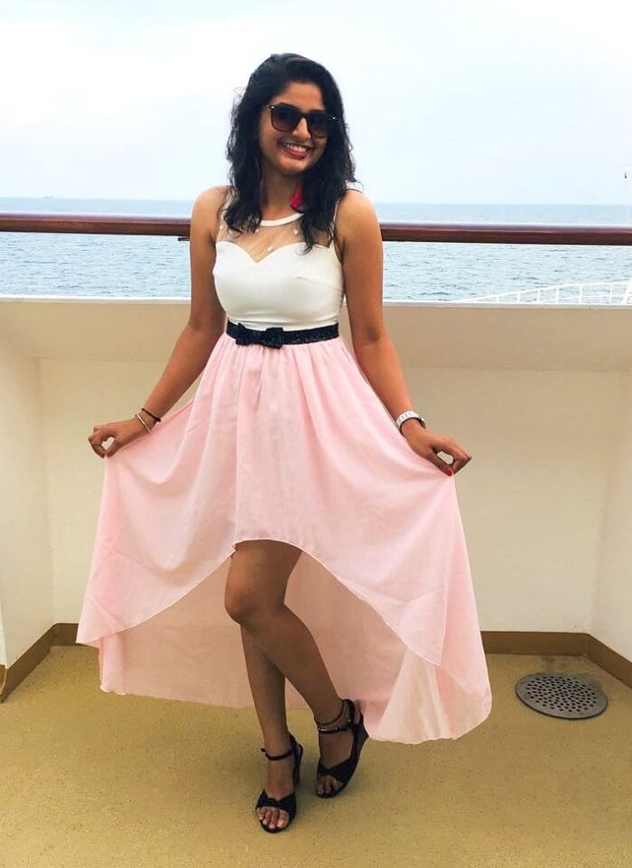 saurabhi singapore family trip: saurabhi posing in dress in cruise