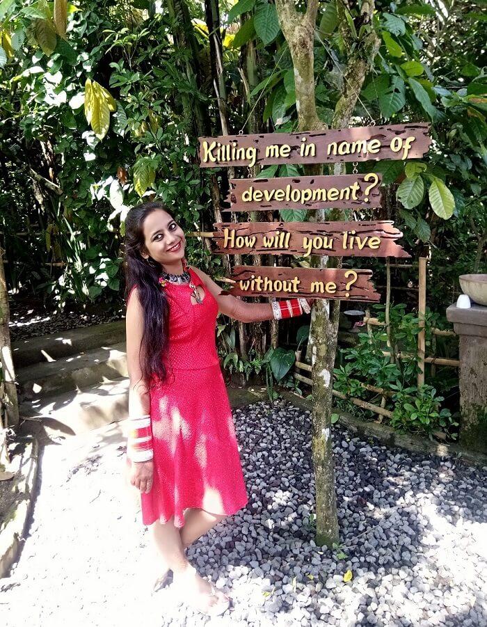pankaj honeymoon trip to bali: posing near clean bali sign