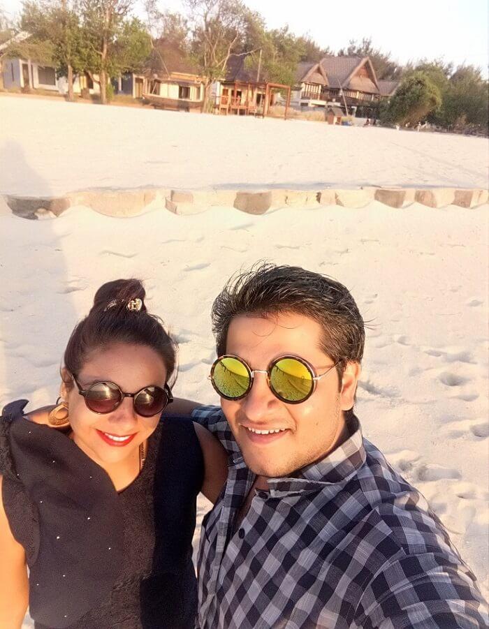 pankaj honeymoon trip to bali: pankaj & wife on beach in gili