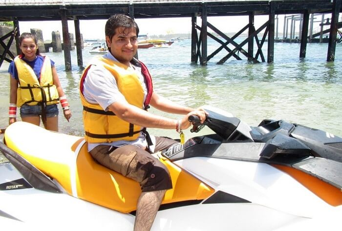 pankaj honeymoon trip to bali: pankaj posing on a jetski
