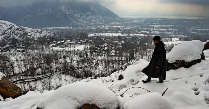Local kid post snowfall in Kashmir