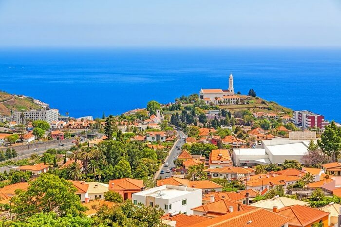 Church of Sao Martinho - a civil parish in the municipality of Funchal. View from Pico dos Barcelo - south coast of Madeira - Atlantic Ocean in the background.