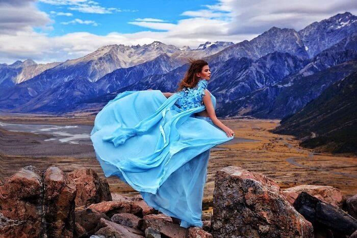 Solo female traveler in a flowy dress