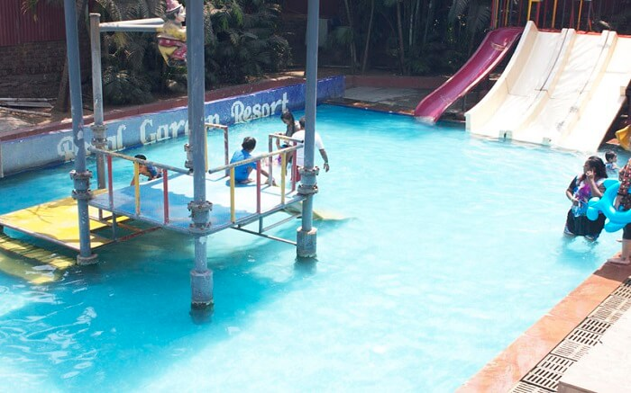 People playing in the waterpark of Royal Garden Resort in Mumbai