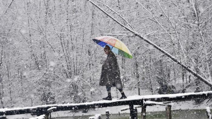 Local during snowfall in Kashmir