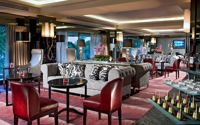 Sofas placed in cafe of a luxurious hotel