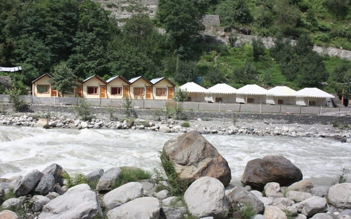 Tents of Kia Camps by the river in Manali