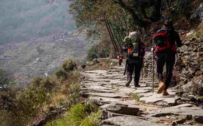 Travelers walking a trek near Rishikesh in Uttarakhand