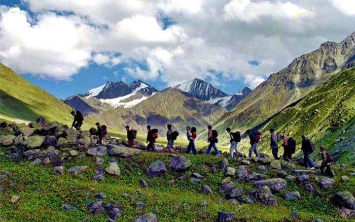 Trekkers en route to Kuari Pass in Uttarakhand