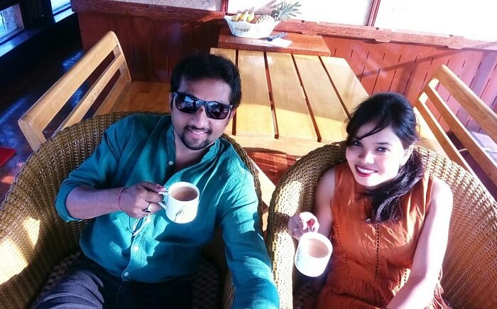 Couple enjoying breakfast on a houseboat