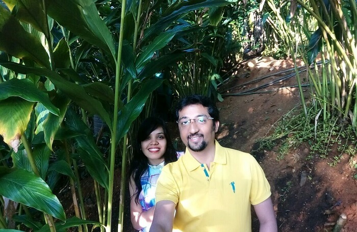 Couple exploring hidden garden in Munnar