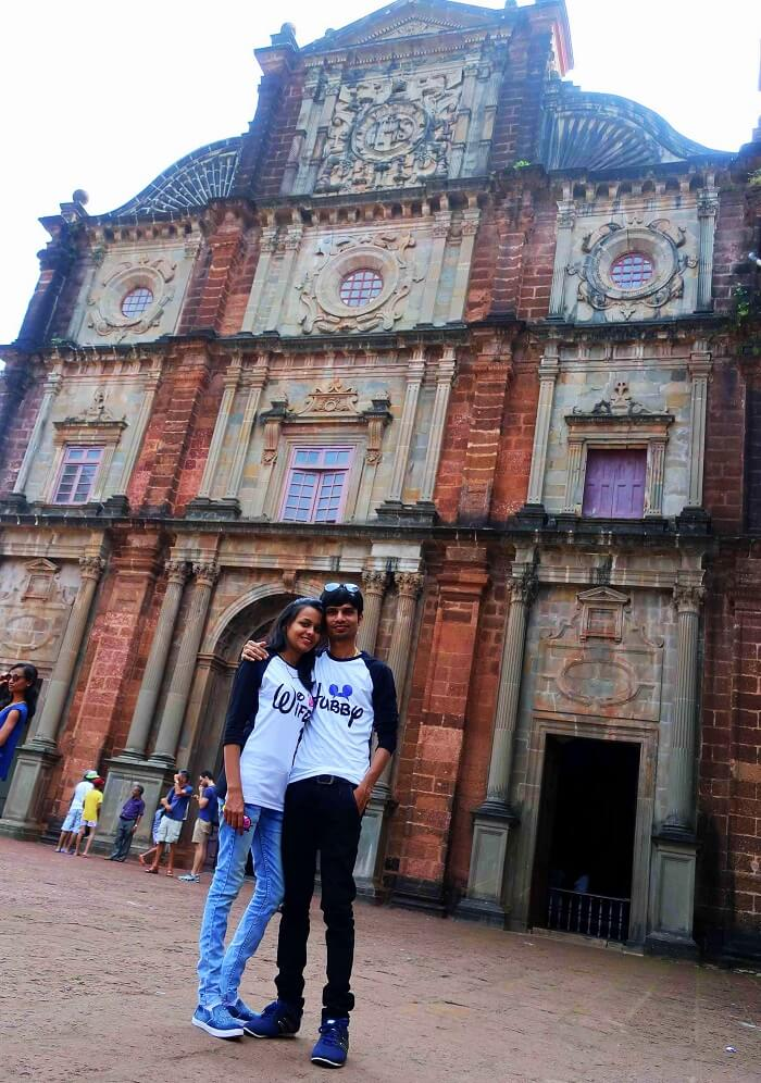 Couple visits a church in Goa
