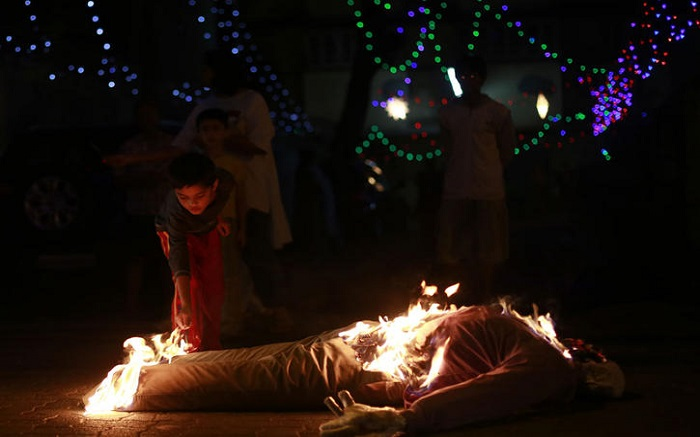 A child burning an effigy in Goa on the Christmas eve