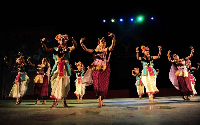 Manipuri people dancing on stage during a festival