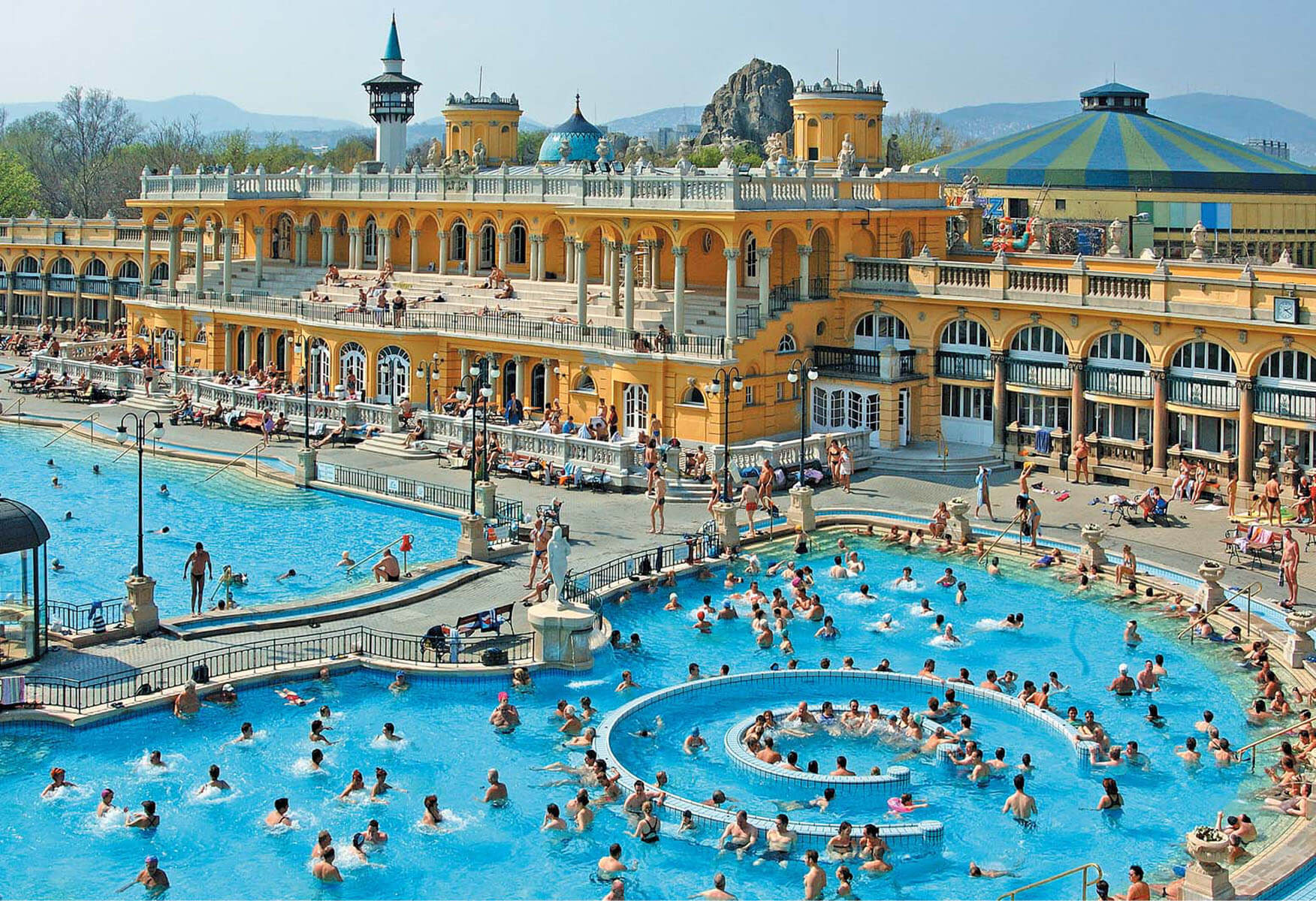 hundreds of people enjoying in an open pool