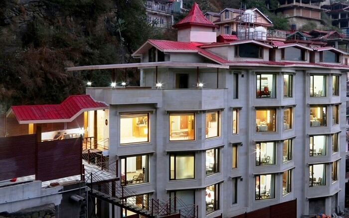 View of a well-lit Rock Castle Hotel in Shoghi