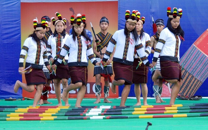 Young girls of Manipur performing bamboo dance