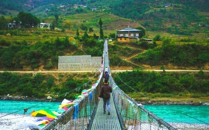 A traveler crossing the bridge leading to Haa Valley