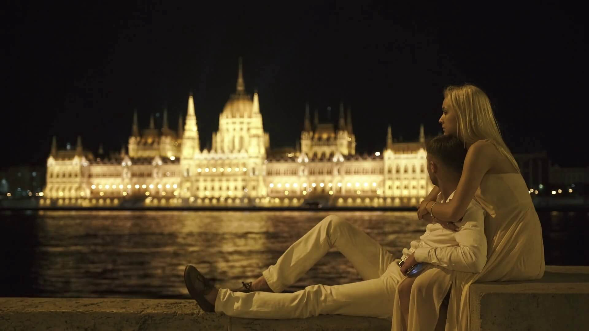 a couple sitting by the waters in Budapest