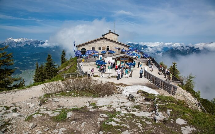 hitler's eagles nest on a cliff surrounded by mountains