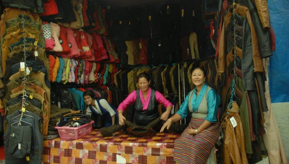 two women selling woolen clothes