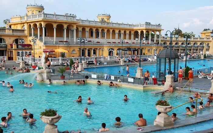 people enjoying hot bath in a spa pool