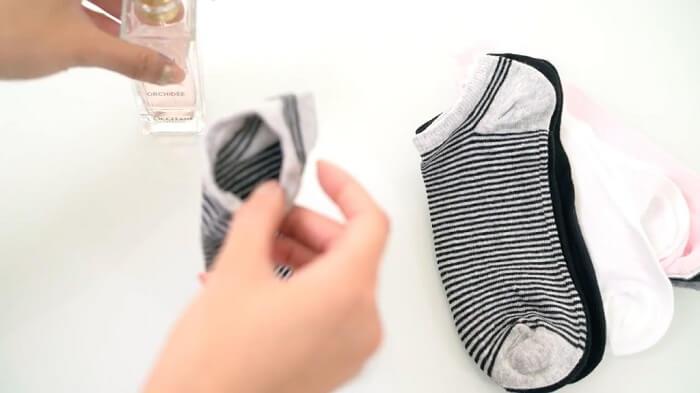 perfume bottle in socks