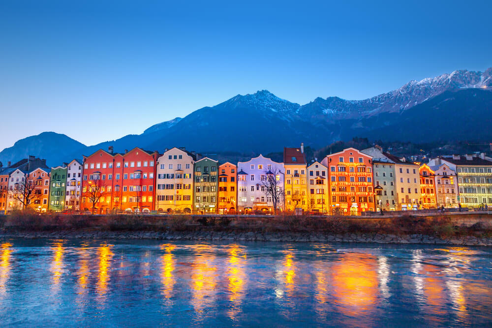 Colourful homes by water in Innsbruck