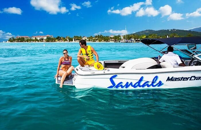Couple enjoying watersports at Sandals Resort Jamaica